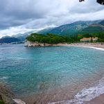Cloudy skies and sandy beach in the bay near Sveti Stefan in Montenegro. The area is about 15 minutes outside Budva.