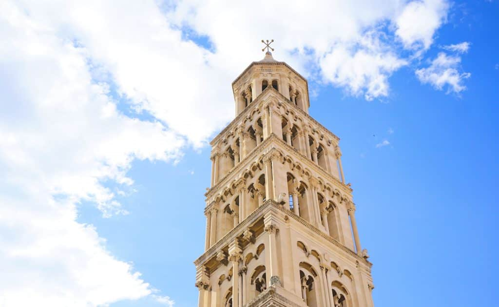 Stone, gothic bell tower with clouds. The Bell Tower is one of many things to do in Split, Croatia.