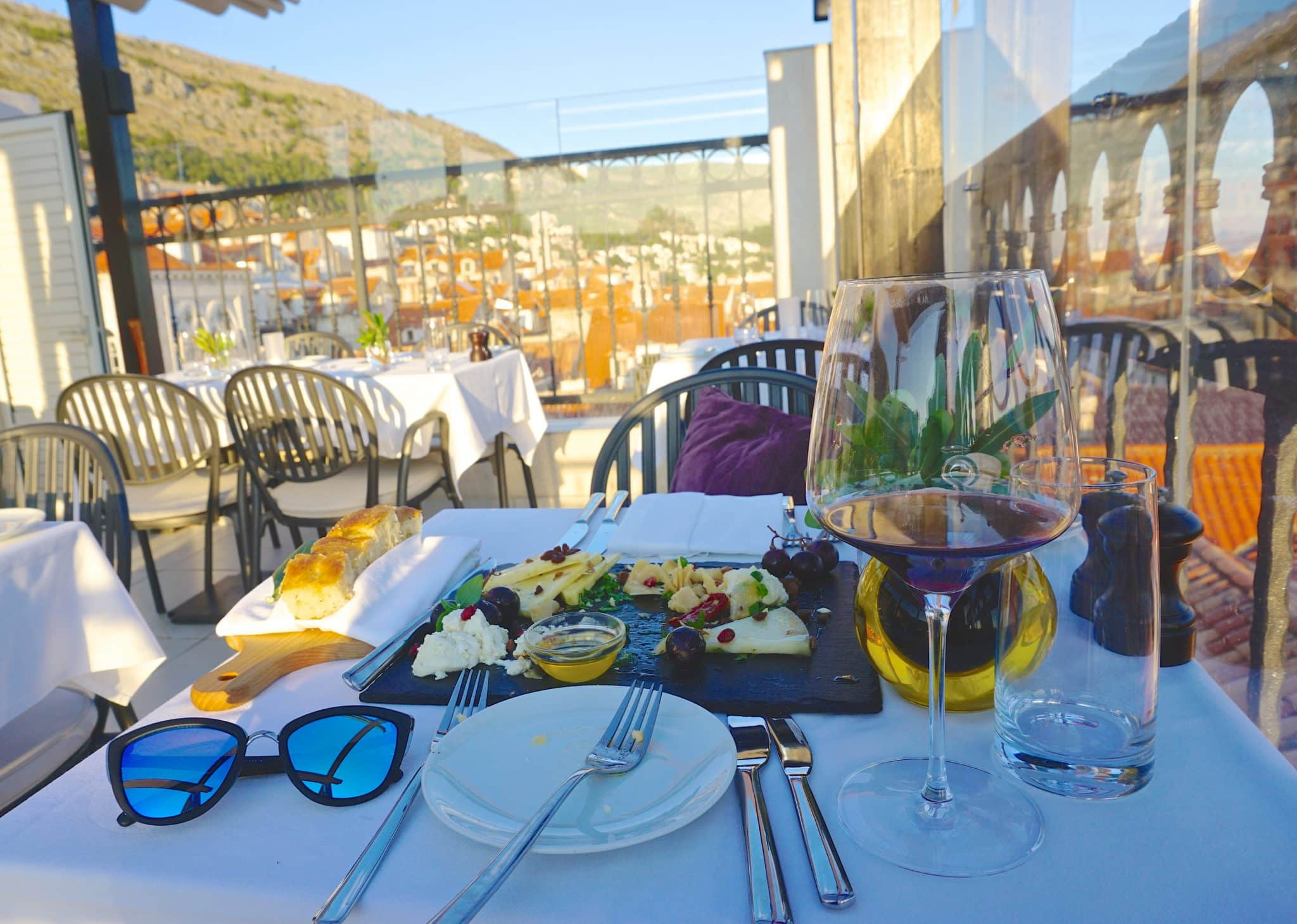 Cheese and olive oil plate with red wine at Above 5 overlooking Dubrovnik's Old Town in Croatia. This is one of the best restaurants in Dubrovnik with a view.