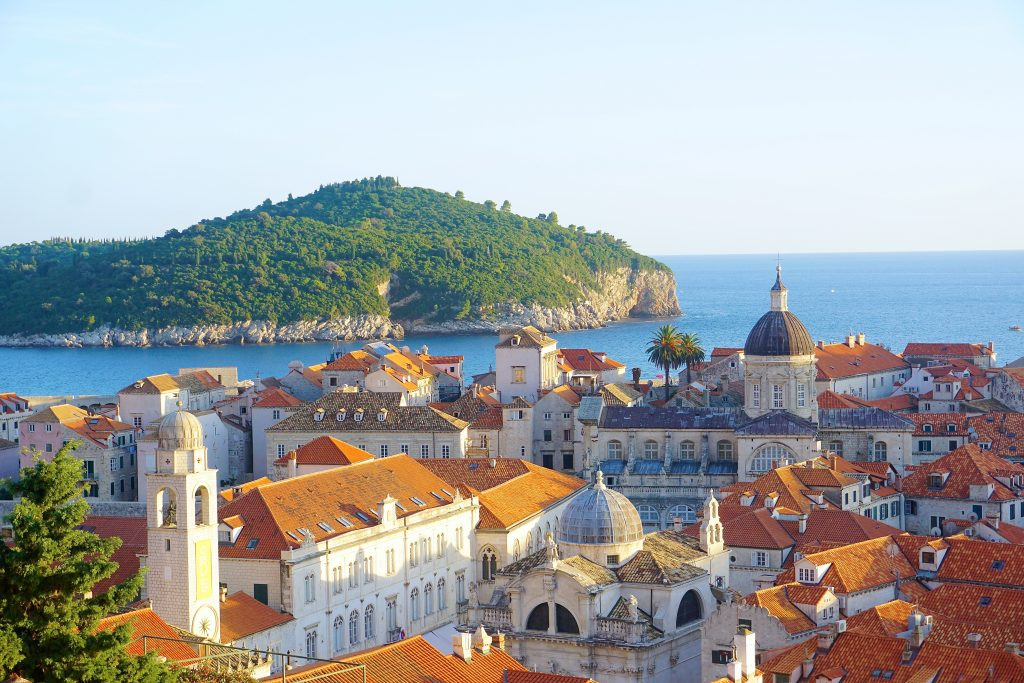 A view of orange rooftops and the Adriatic sea, in the Old Town of Dubrovnik, Croatia.