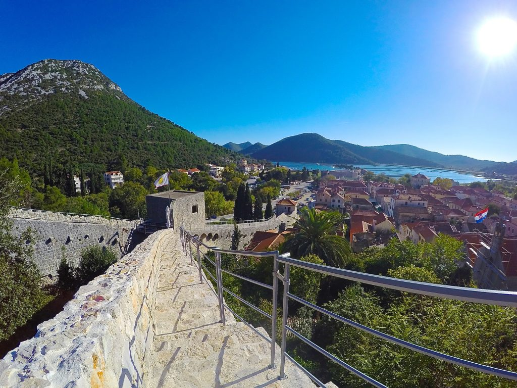 View of Ston from the walls of Ston, the second largest fortress walls in the world. Ston is a perfect day trip from Dubrovnik, Croatia.
