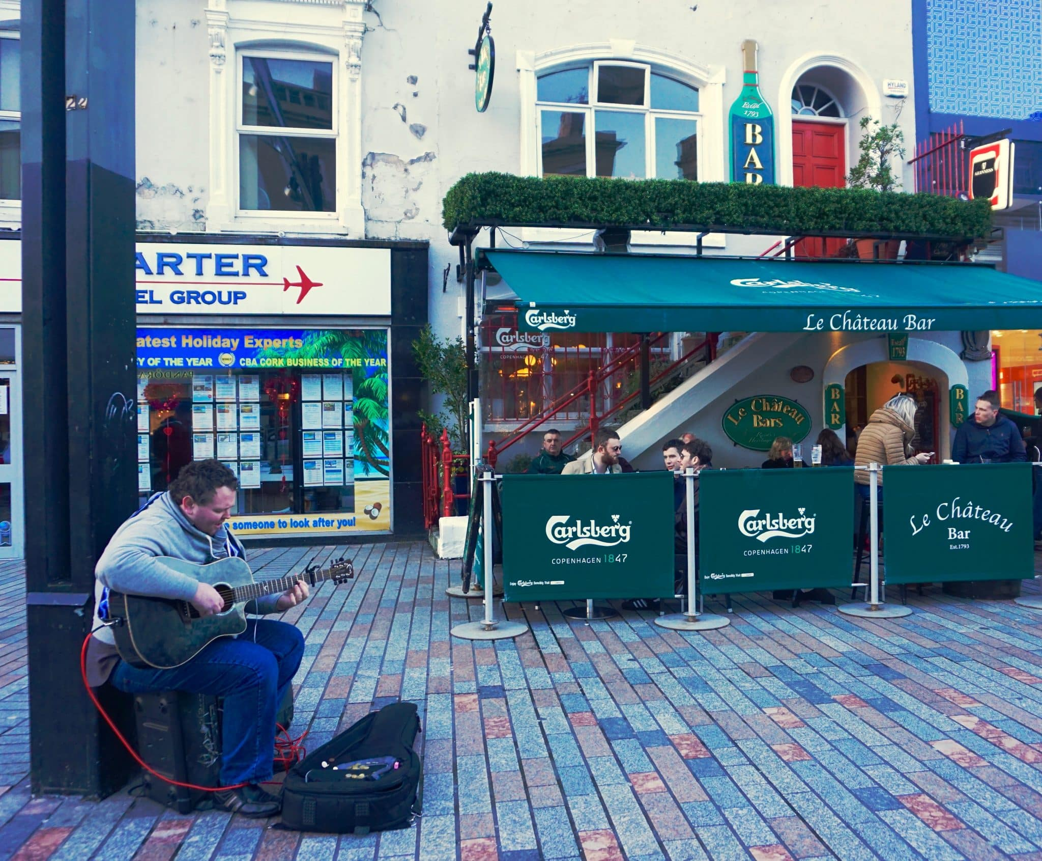 Man playing on the streets of Cork, Ireland. Cork City is a great place in Ireland for live music.