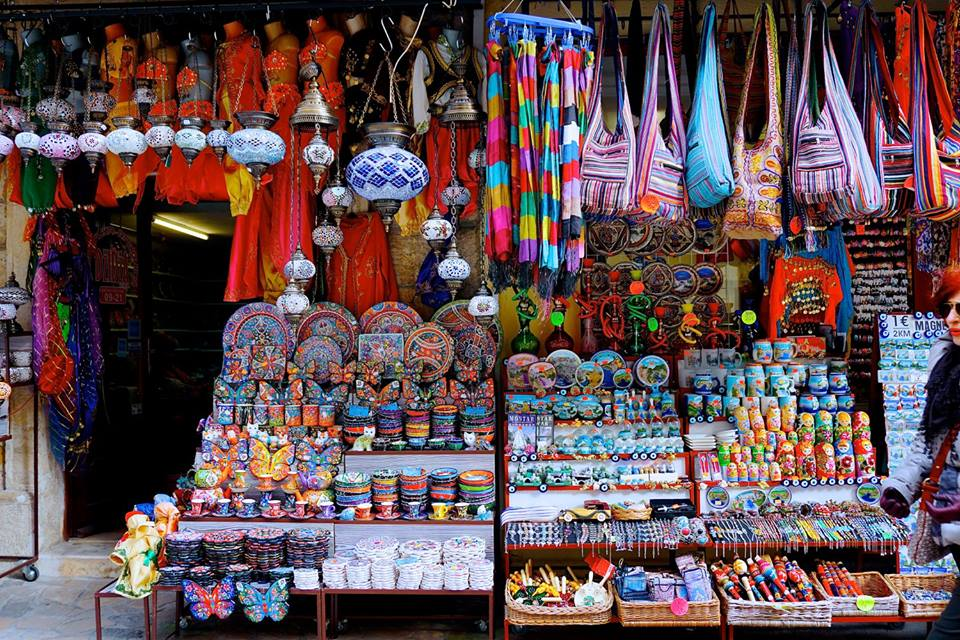 THINGS TO DO IN DUBROVNIK: Shop with Turkish mosaic lamps and colorful plates and souvenirs within the Mostar Bazaar in Bosnia and Herzegovina.