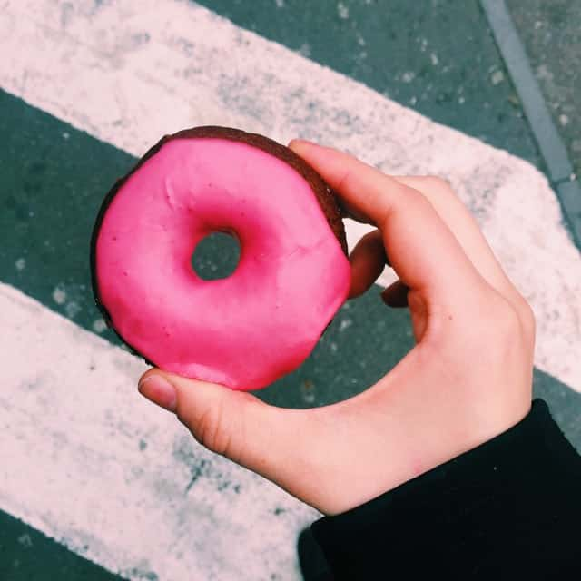 Pink vegan and gluten free donut in Boxpark near Shoreditch high street in London.