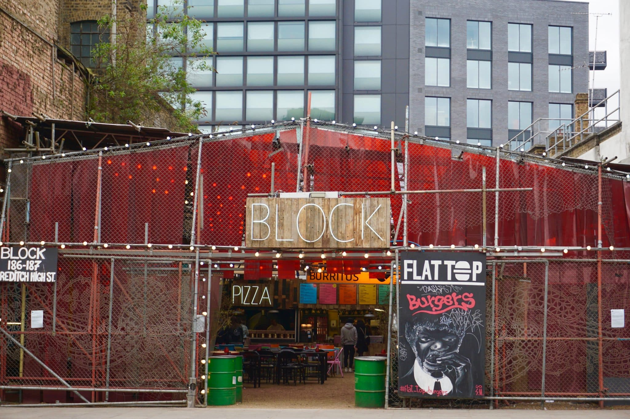 Block near Shoreditch highstreet London with various street food vendors in an industrial setting.