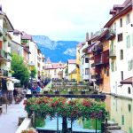 """Annecy, France is nested in the Swiss Alps and a popular day trip from Geneva, Switzerland. It is also known as the """"Venice of the Alps"""""""