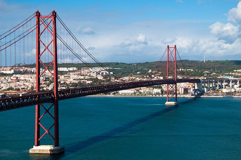 Ponte 25 de Abril in Lisbon, Portugal, a red bridge over the Tagus river that looks like the Golden Gate Bridge in San Fran.