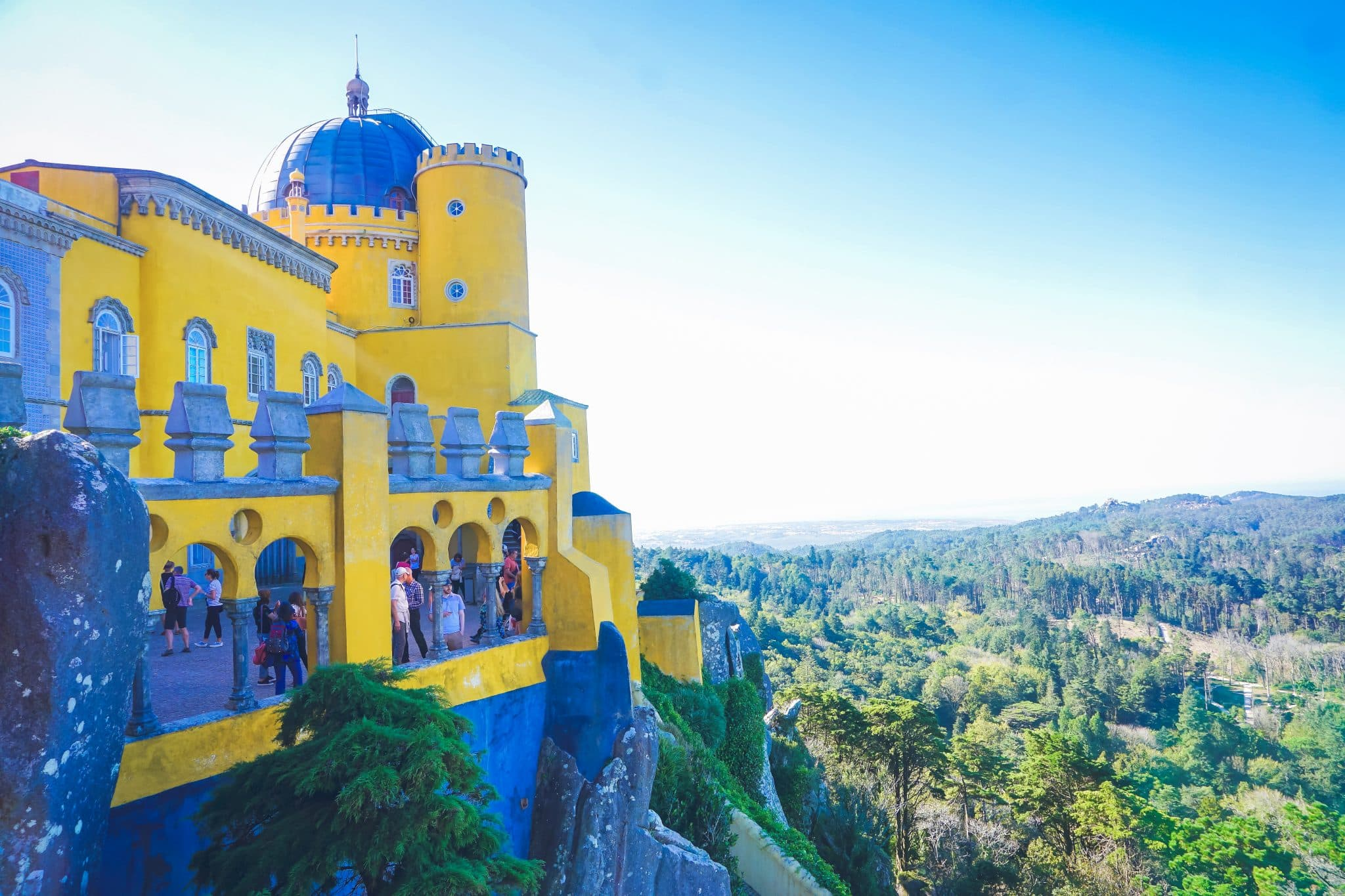 Pena Palace overlooking the valley of Sintra, with green forests, a perfect day trip from Lisbon, Portugal.