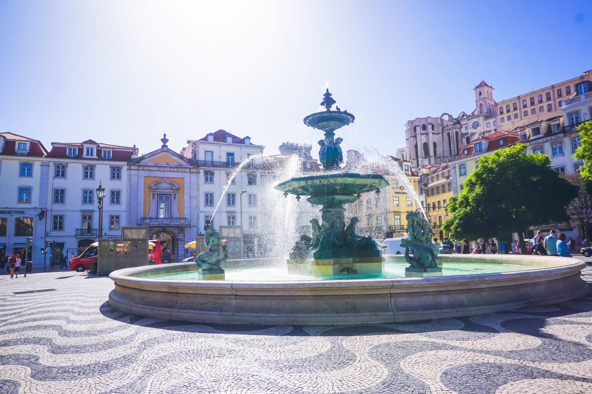 Rossio's square in Lisbon, Portugal, featuring tiles, a fountain and colorful buildings. This square survived the earth quake.