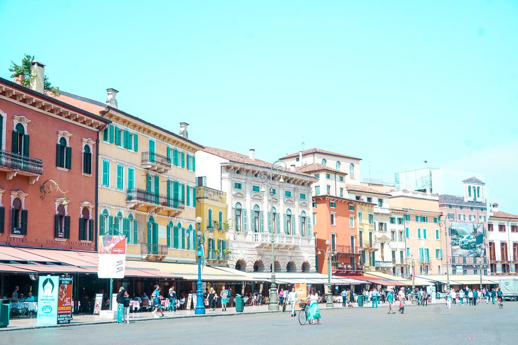 Colorful buildings in Verona, Italy near the Verona Arena. The area is ideal for coffee, drinks or dinner.