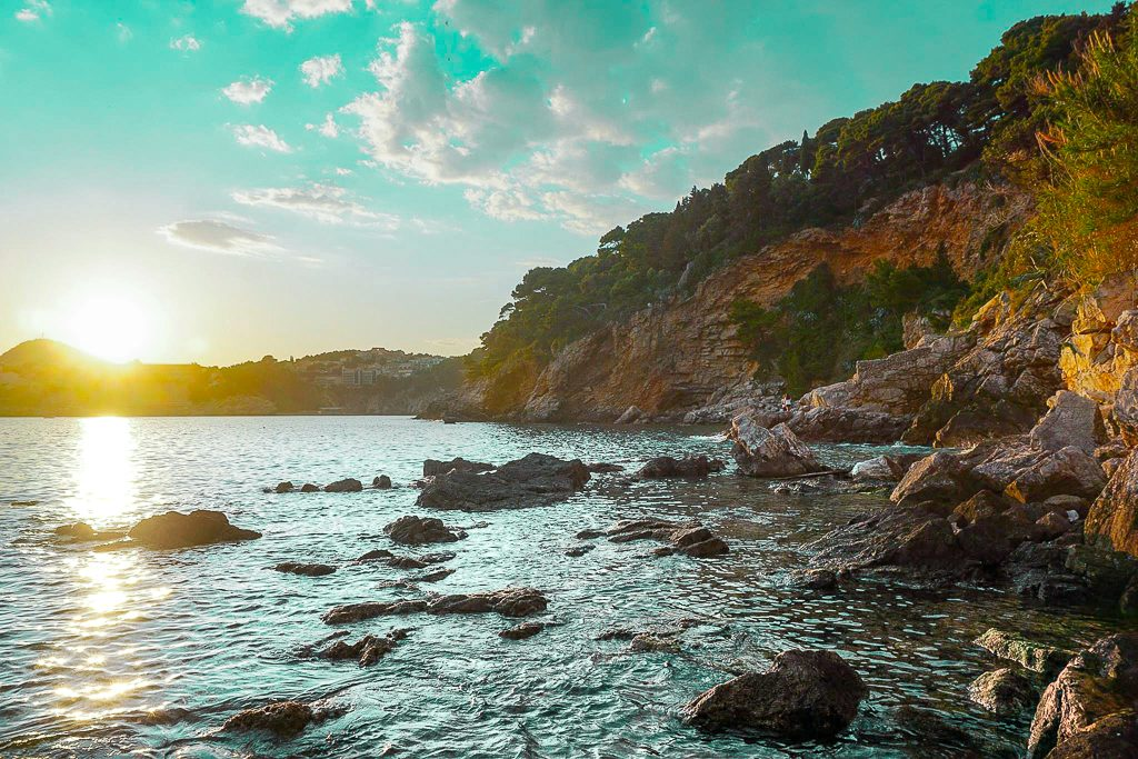 Dubrovnik beaches. Dance beach sunset with rocks and cliffs on the Adriatic.