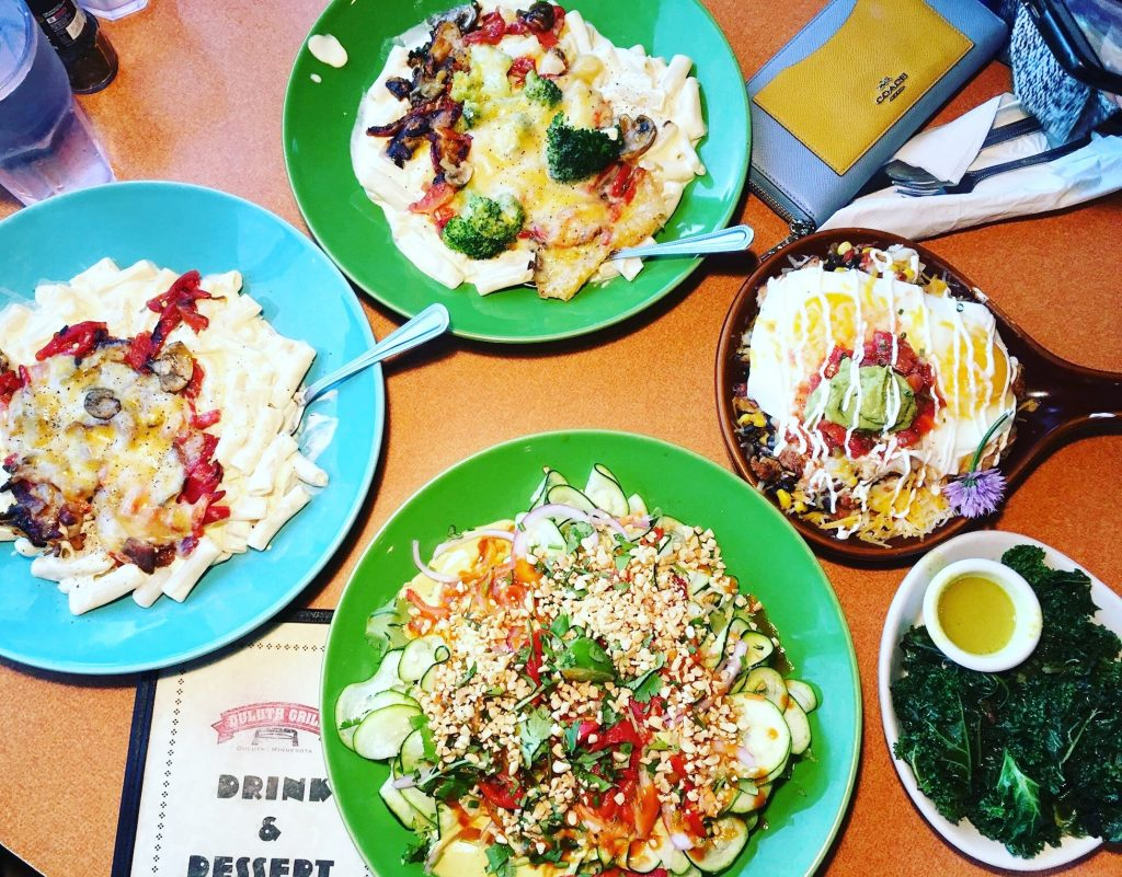 A flat lay of 4 dishes from the Duluth Grill, in Duluth, Minnesota. Breakfast is served all day and is one of the most iconic restaurants in Duluth.