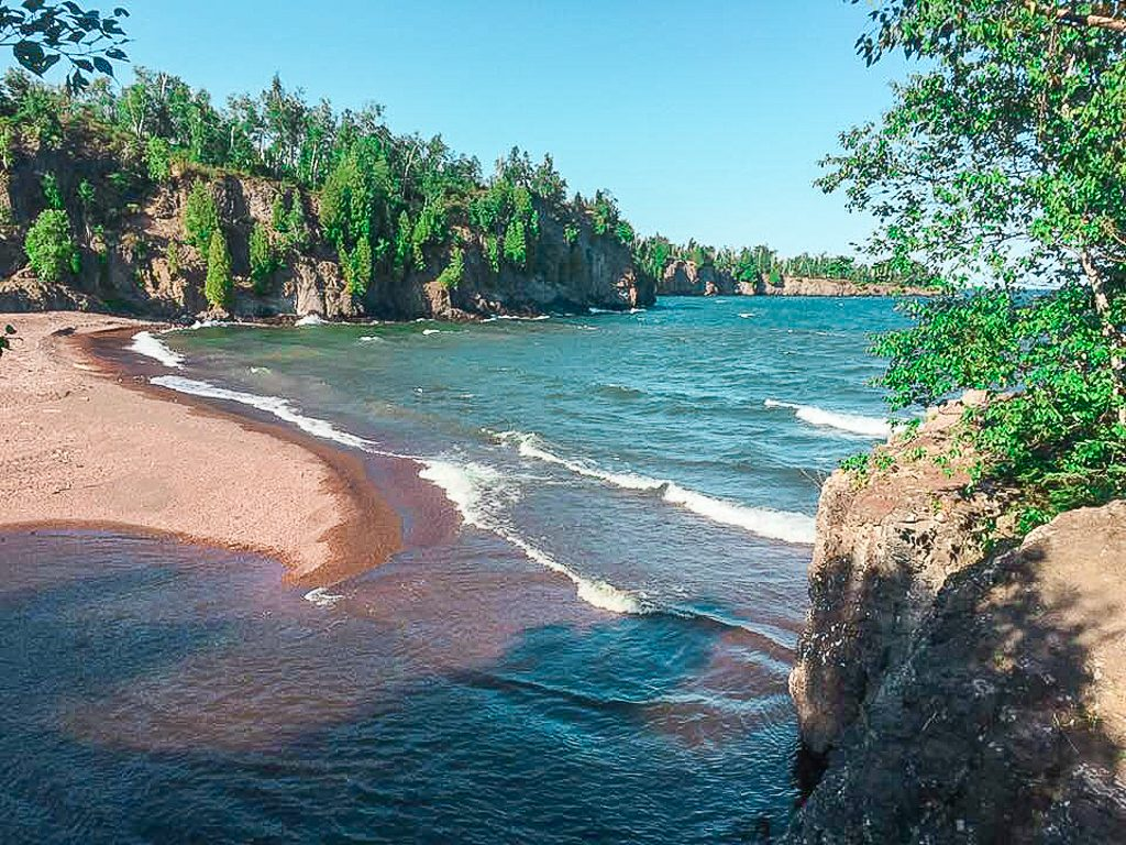 View from the Superior Hiking Trail near Gooseberry Falls. The beach is of Lake Superior and surrounding pines
