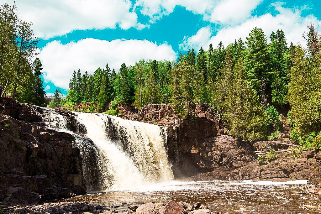 View from the bottom of Gooseberry Falls with pine trees and waterfalls. The falls are near Duluth and Two Harbors, Minnesota