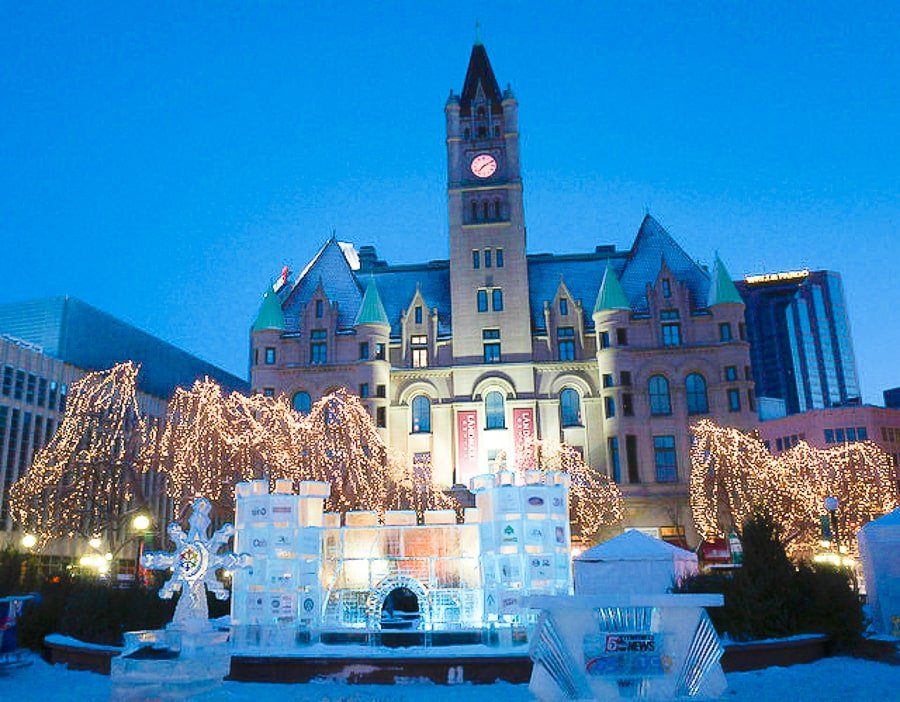 Rice Park's winter carnival with ice sculptures and holiday lights, overlooking Minnesota Landmark Center in St.Paul