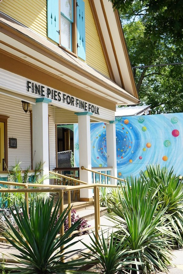 """Fine pies for fine folks"" sign outside Emporium pies in the Bishops Arts District."
