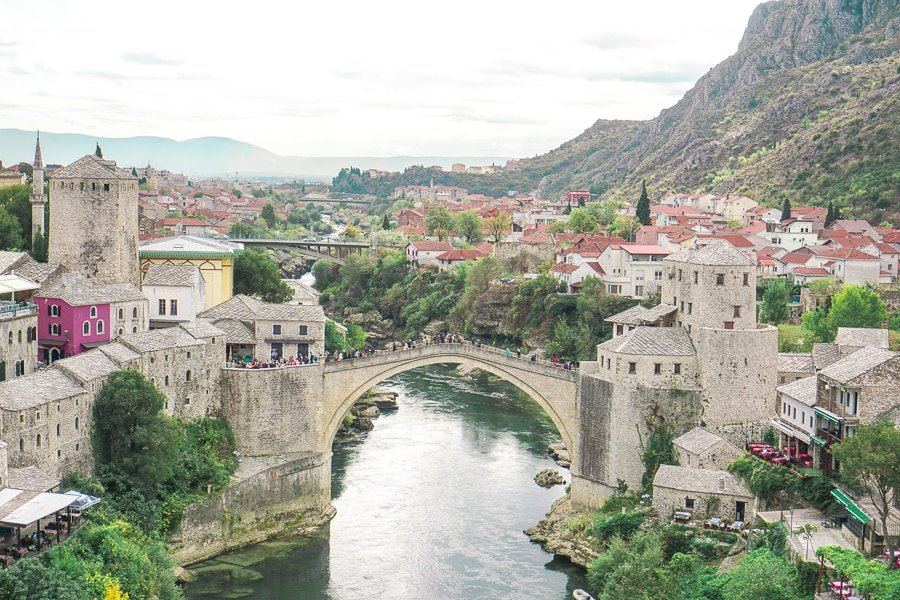 View from the Mostar Mosque of Mostar Bridge and Old Town with river and Ston buildings. Mostar is a popular day trip from Split and Dubrovnik.