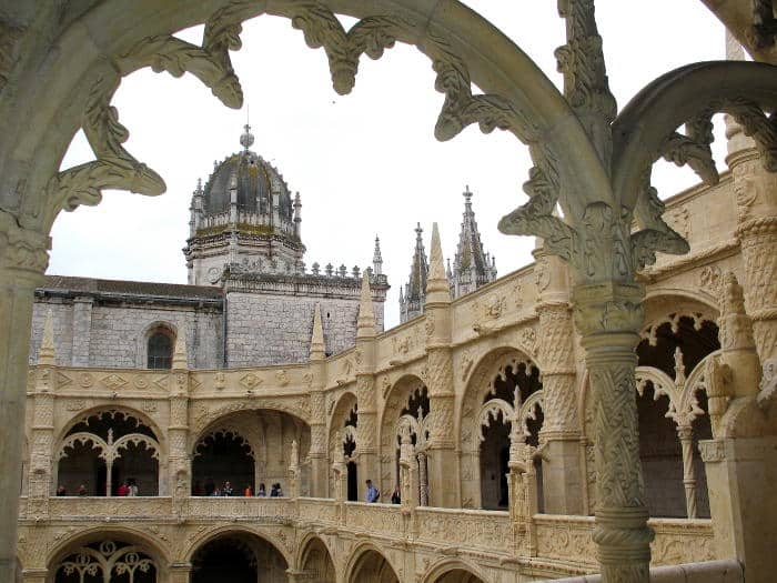 Archway of the Jeronimos Monastery near Lisbon, Portugal with Gothic architecture in an open air setting.