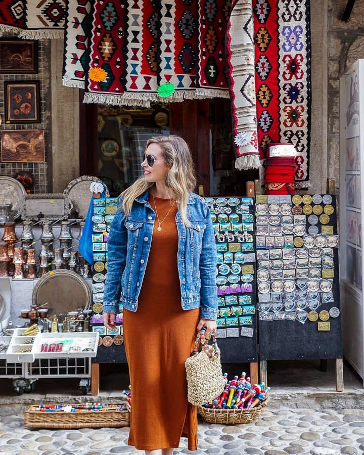 Walking through the Mostar Bazaar, with many colors, rugs, Turkish lamps, and handmade goods