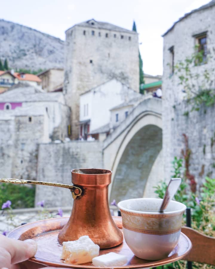 A Bosnian coffee on a tray overlooking the Mostar Bridge. Mostar is one of the best Dubrovnik day trips.