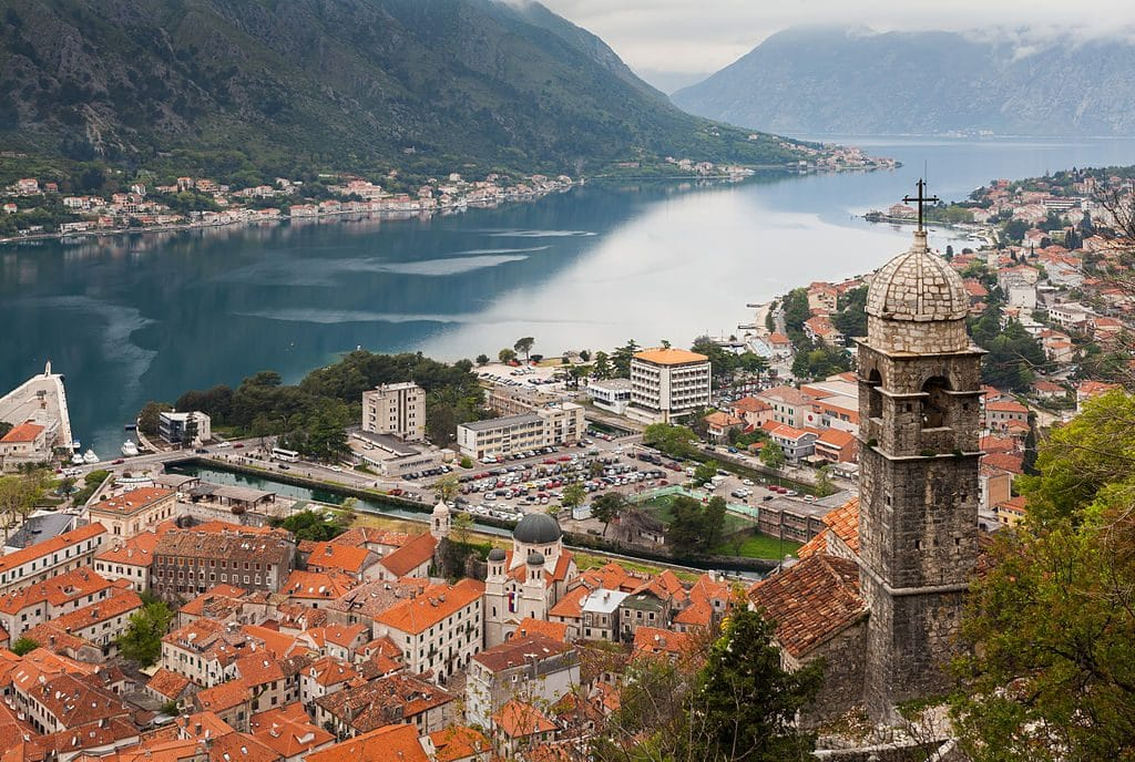 View from the Walls of Kotor, overlooking the Kotor Bay, Stone Old Town, and the surrounding mountains. Kotor is one of the most popular Dubrovnik day trips.