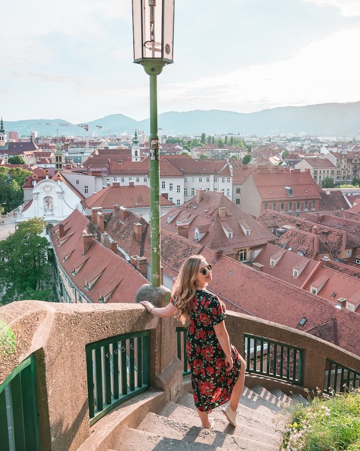 Woman looking over the European town of Graz, known as the culinary capital of Austria.
