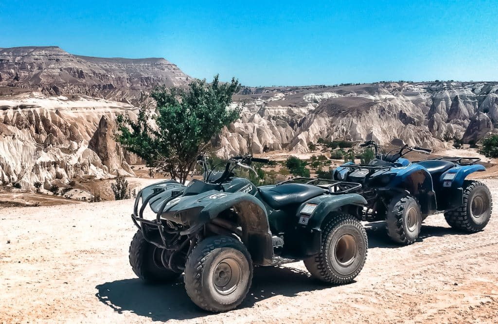 Two ATV bikes overlooking the Rose Valley of rock formations in Cappadocia, Turkey.
