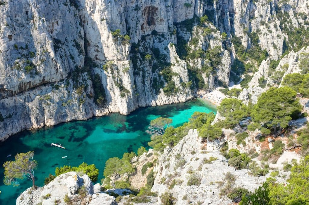 Calanque d'en Vau birds eye view, featuring an inlet overlooking the clear sea water.