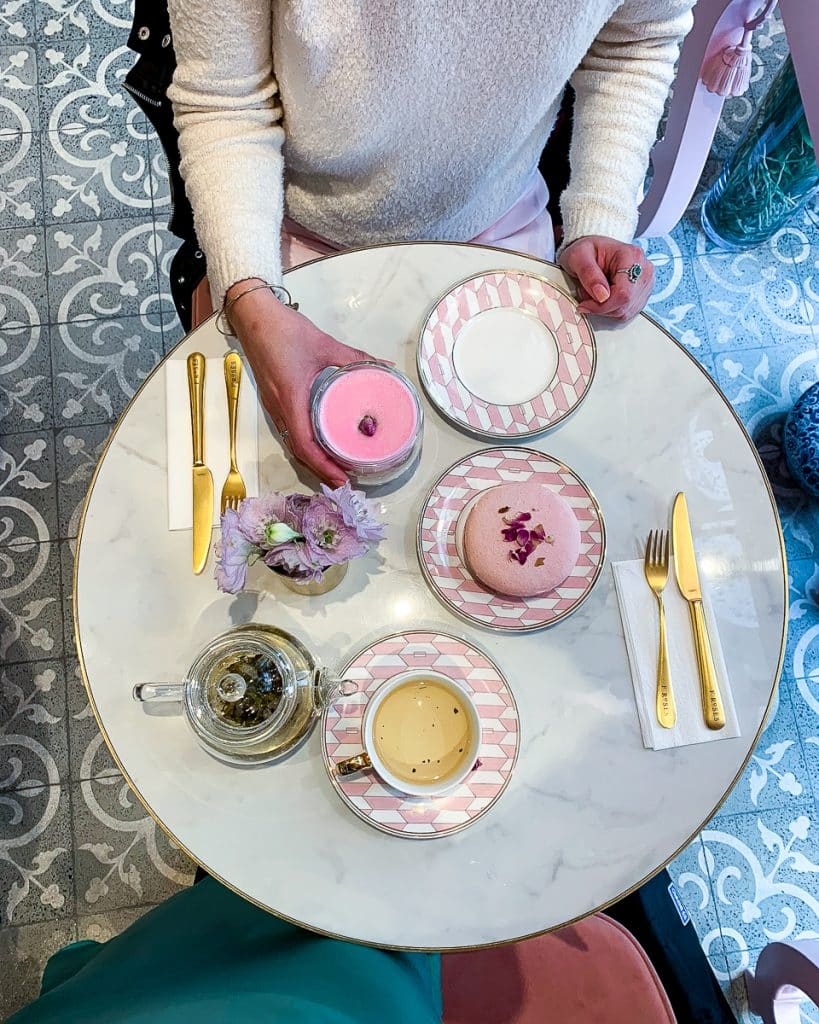 Flat lay of a pink macaroon, rose latte, and rose tea at F'roses. This is a popular Instagram spot and cafe in Istanbul.