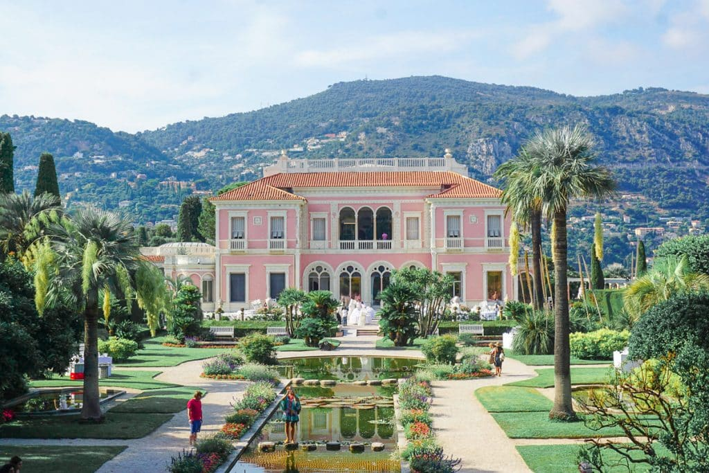 Pastel pink house and palm gardens of Villa Ephrussi de Rothschild in Jean Saint Cap Ferrat.