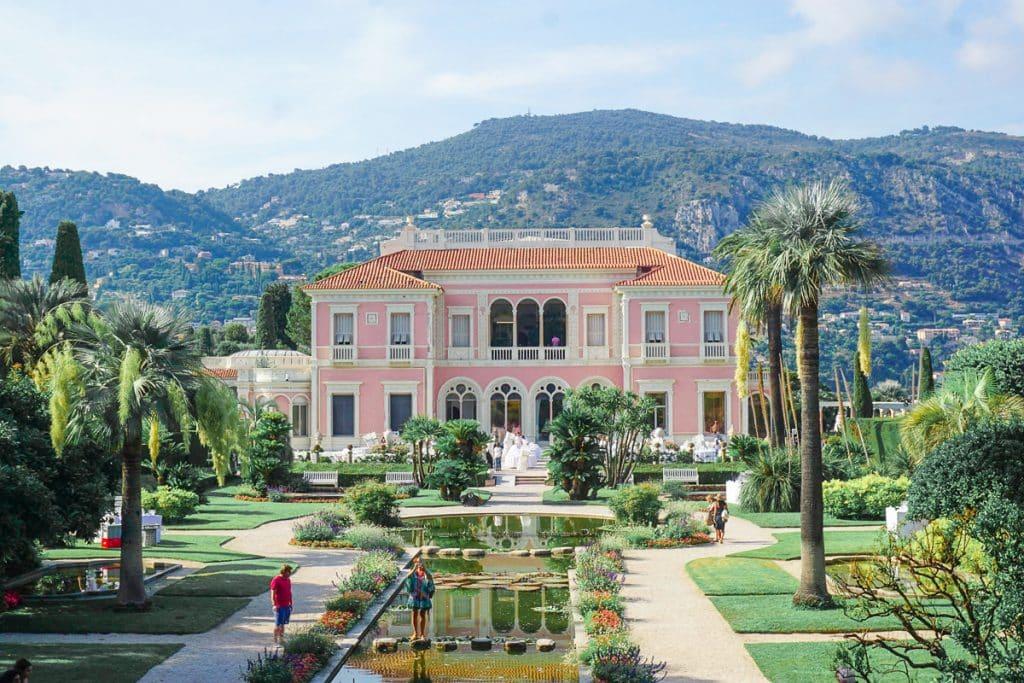 Pastel pink house and palm gardens of Villa Ephrussi de Rothschild in Jean Saint Cap Ferrat.