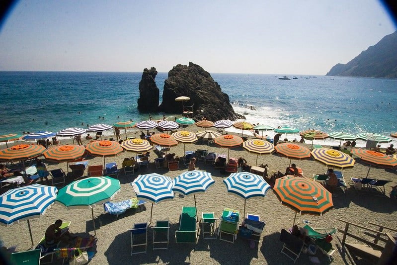 Cinque Terre Train guide: Monterosso Beach with colorful umbrellas.