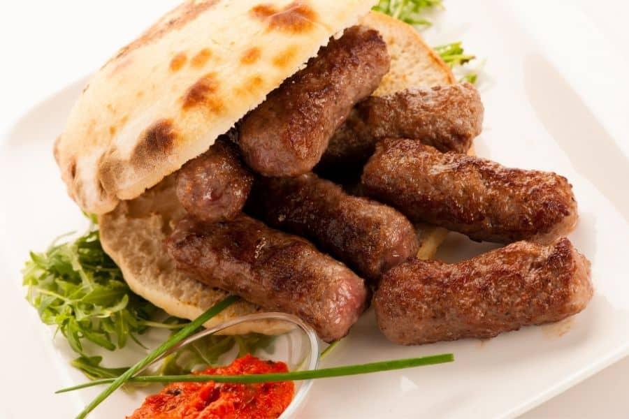 Cevapi or cevapcici balkan skinless sausages. Balkan foods