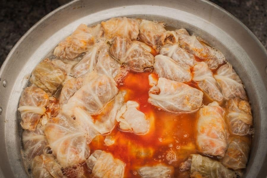 Sarma sour cabbage rolls with meat and rice in tomato sauce.